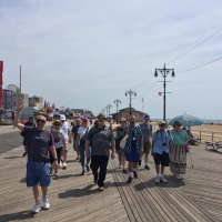 Group of people walking on the Coney Island Boardwalk, Brooklyn, NY